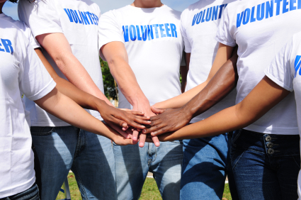 volunteers standing in a circle with arms outstretched